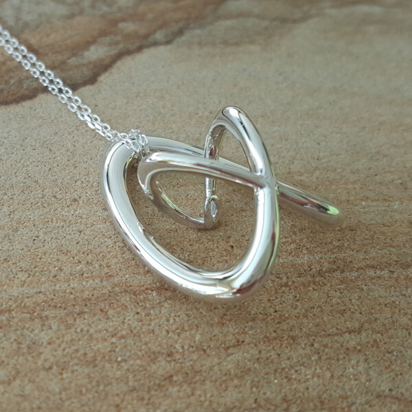 Cradle - Sterling Silver Music Necklace by Techniflow 1